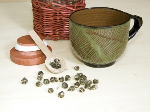 Jasmine green tea called Dragon Tears. With bamboo tea strainer.